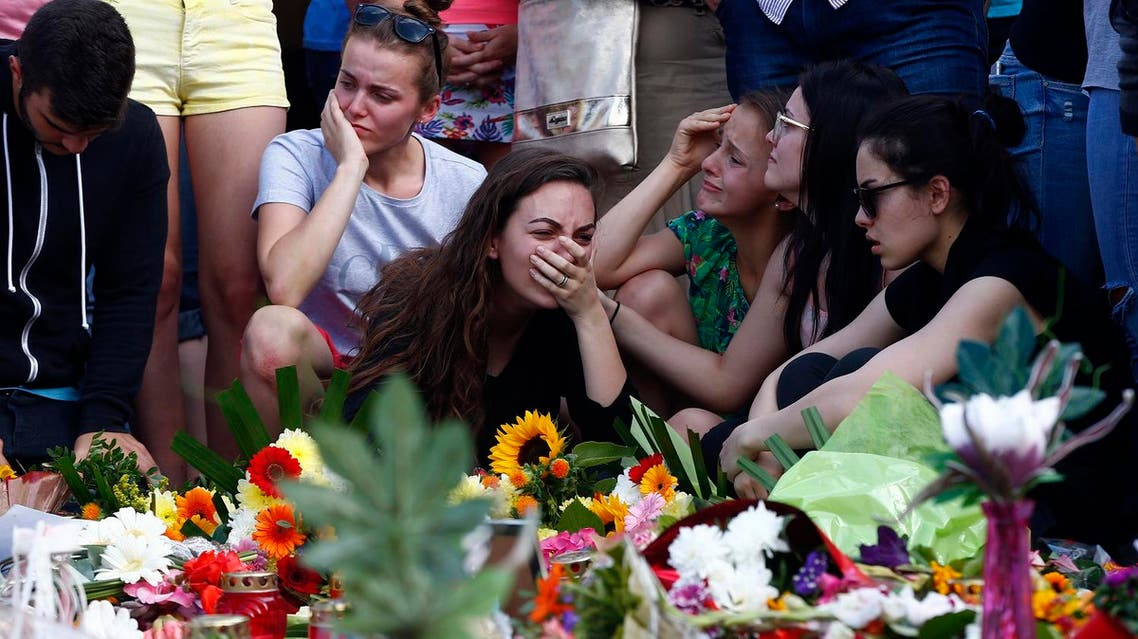 Young women mourning outside the Olympia shopping mall in Munich, Germany July 24, 2016. REUTERS/Arnd Wiegmann