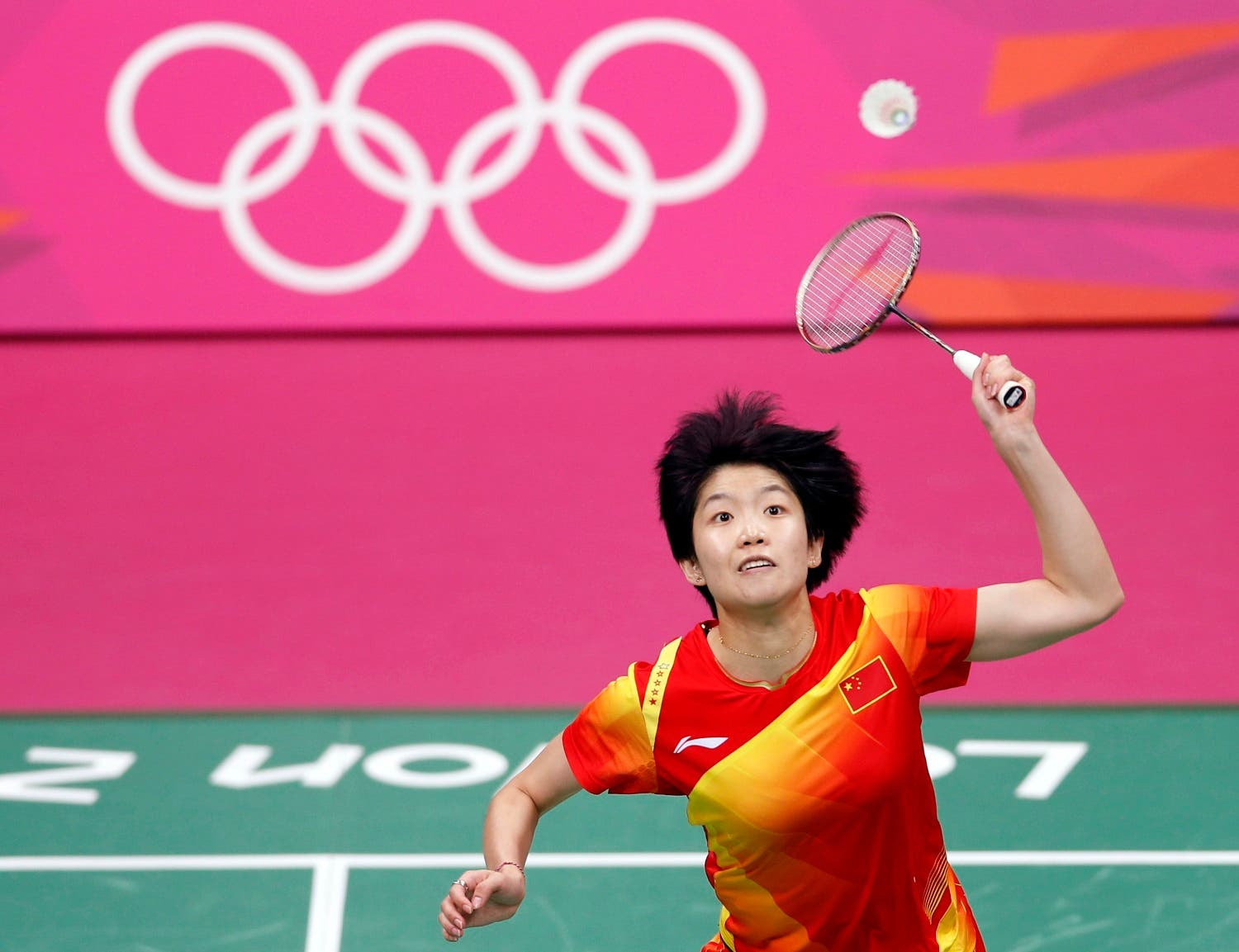 China's Wang Xin returns a shot to India's Saina Nehwal during their women's singles badminton bronze medal match at the London 2012 Olympic Games at the Wembley Arena August 4, 2012. (Reuters)