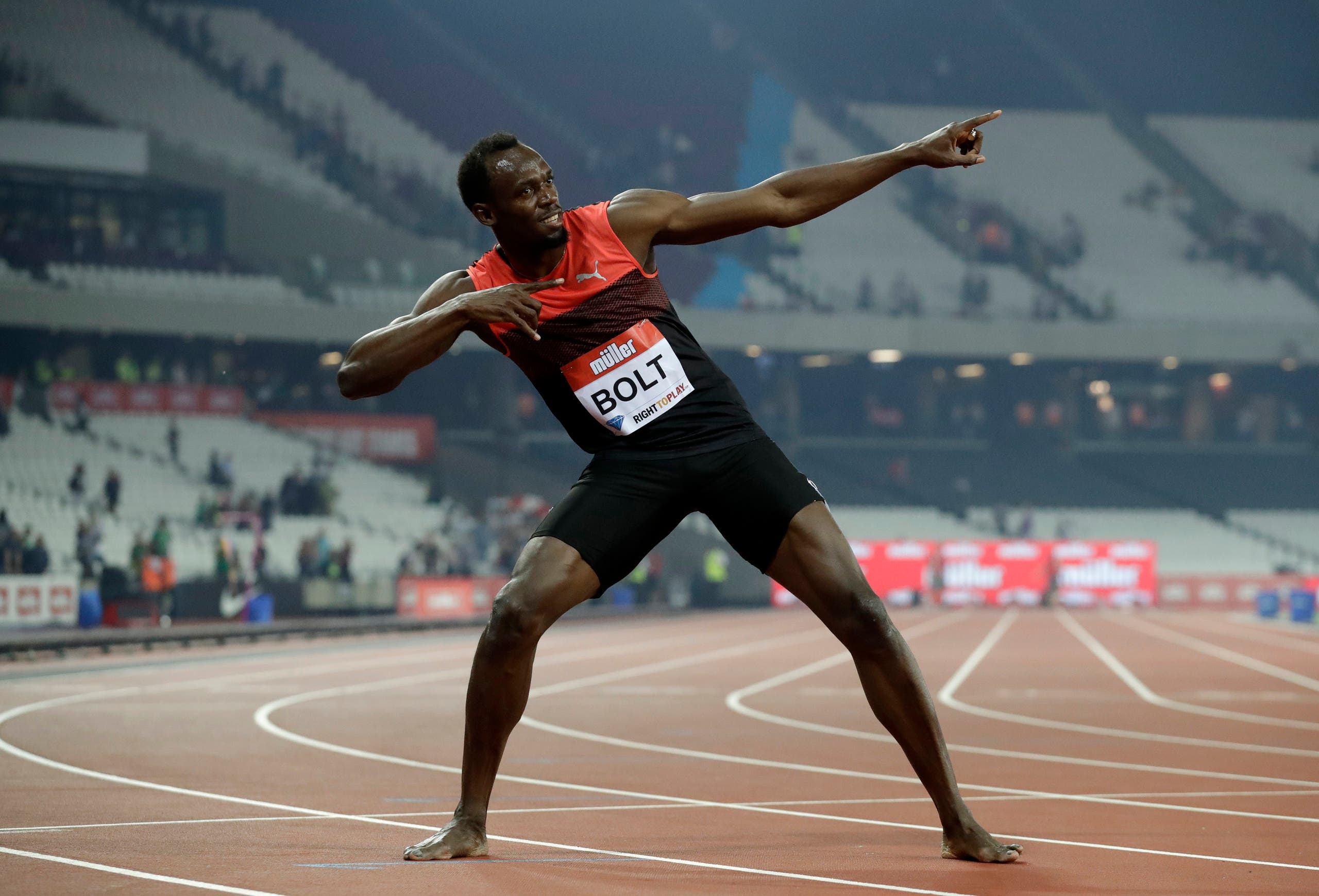 Usain Bolt of Jamaica poses for photographers after he won the men's 200 meter race during the Diamond League anniversary games at The Stadium, in the Queen Elizabeth Olympic Park in London, Friday, July 22, 2016.(AP)