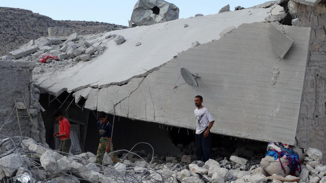 Syrians check a damaged house, reportedly hit by US-led coalition air strikes, in the village of Kfar Derian in the western Aleppo province on September 23, 2014. (AFP)
