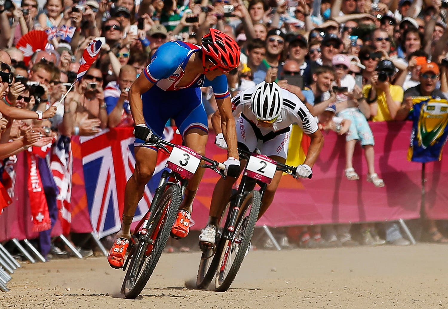 Czech Republic's Jaroslav Kulhavy (L) glances back at Switzerland's Nino Schurter as they approach the finish line during the men's cross-country mountain bike event at Hadleigh Farm at the London 2012 Olympic Games August 12, 2012. Kulhavy won the gold medal in the race, with Schurter taking the silver. (Reuters)