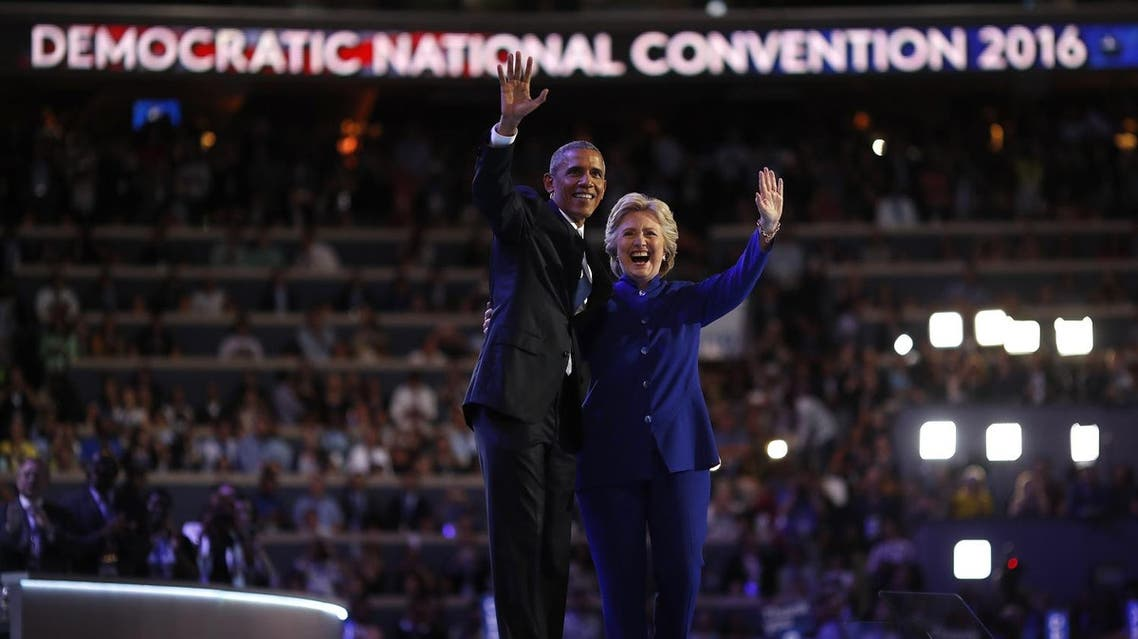 U.S. President Barack Obama and Democratic presidential nominee Hillary Clinton appear onstage together after his speech on the third night at the Democratic National Convention in Philadelphia, Pennsylvania, U.S. July 27, 2016. REUTERS/Carlos Barria