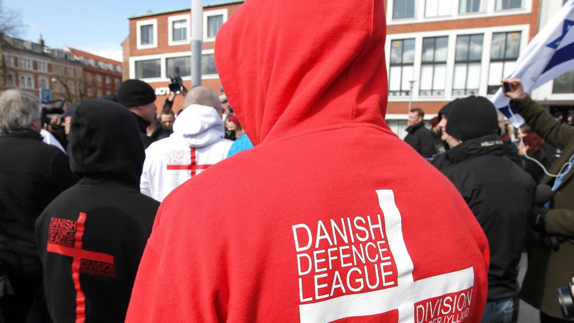 A supporter of the far-right group Danish Defence League walks during at an anti-Islamic rally on March 31, 2012 in Aarhus. (AP)