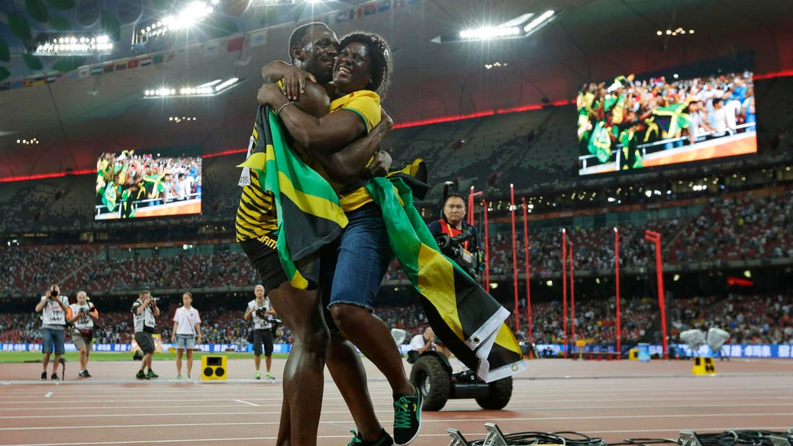 In this Aug. 23, 2015 file photo, Jamaica's Usain Bolt hugs his mom, Jennifer Bolt, after winning the men's 100m final at the World Athletics Championships at the Bird's Nest stadium in Beijing. AP