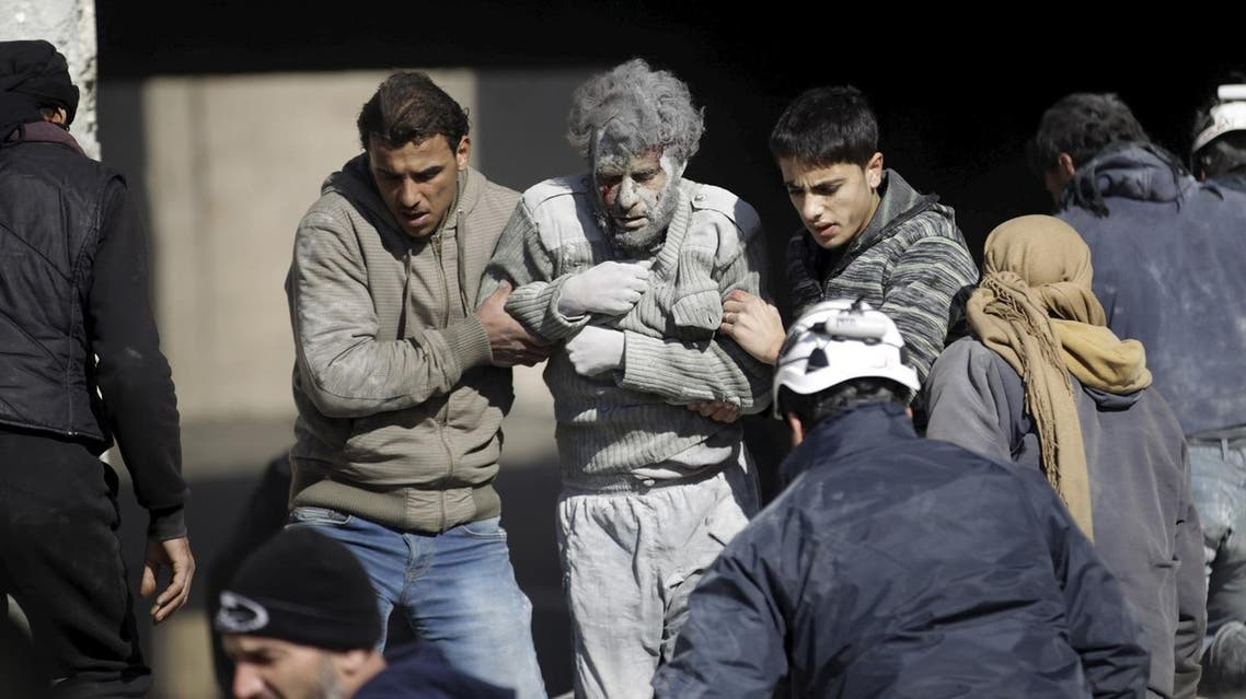 ATTENTION EDITORS - VISUAL COVERAGE OF SCENES OF DEATH AND INJURYResidents help an injured man in a site hit by what activists said were airstrikes carried out by the Russian air force in the rebel-controlled area of Maaret al-Numan town in Idlib province, Syria January 9, 2016. At least 70 people died in what activists said where four vacuum bombs dropped by the Russian air force in the town of Maaret al-Numan; other air strikes where also carried out in the towns of Saraqib, Khan Sheikhoun and Maar Dabseh, in Idlib. REUTERS/Khalil Ashawi