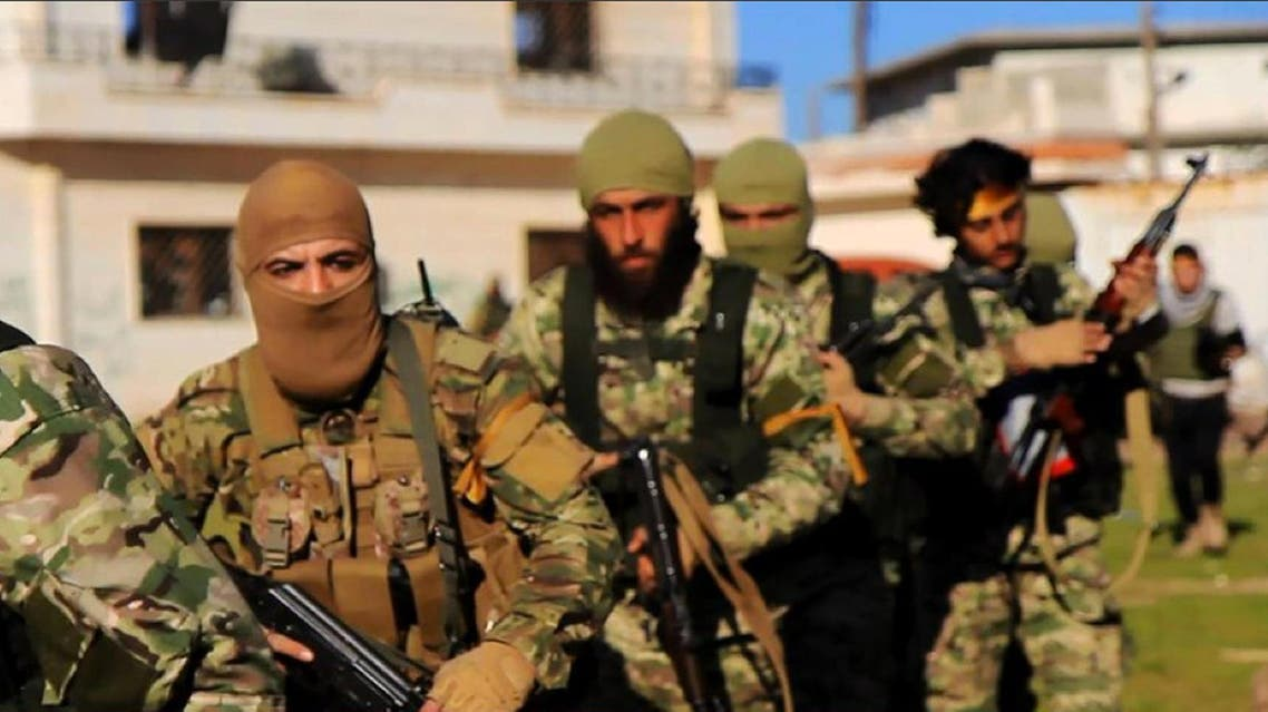 This file photo posted on the Twitter page of Syria's al-Qaida-linked Nusra Front on April 1, 2016, shows fighters from al-Qaida's branch in Syria, ap