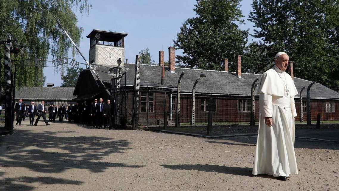 Pope Francis walks through the gate of the former Nazi German death camp of Auschwitz in Oswiecim, Poland, Friday, July 29, 2016 (Photo: AP)