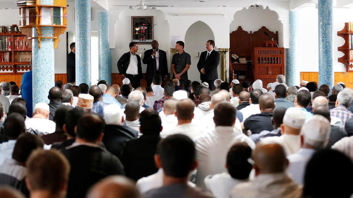 """Priest Auguste Moanda addresses an audience, flancked by Mohammed Karabila, President of the Muslim Regional Council of Haute-Hormandie and director of the mosque Yahya in Saint-Etienne-du-Rouvray (L), Priest Pierre (2nd R) in charged of the relations with other religions, and Anouar Kebibech, president of the CFCM (R), on July 29, 2016 in Saint-Etienne-du-Rouvray, where a French Catholic priest Jacques Hamel was killed on July 26, in the latest of a string of attacks claimed by or blamed on the Islamic State jihadist group. French President Francois Hollande said that two men who attacked a church and slit the throat of the priest had """"claimed to be from Daesh"""", using the Arabic name for the Islamic State group. Police said they killed two hostage-takers in the attack in the Normandy town of Saint-Etienne-du-Rouvray, 125 kilometres (77 miles) north of Paris. As the two attackers made to leave the church they were confronted by a French police unit specialising in hostage situations, the BRI, and were shot dead.  CHARLY TRIBALLEAU / AFP"""