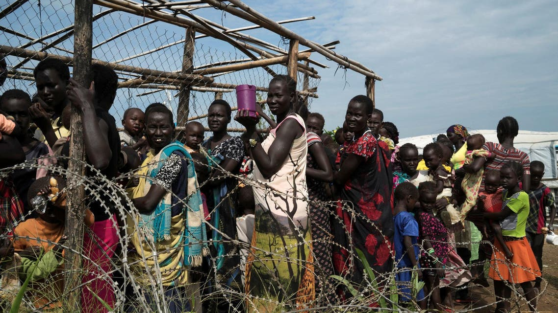 South Sudanese women and children queue to receive emergency food at the United Nations protection of civilians (POC) site 3 hosting about 30,000 people displaced during the recent fighting in Juba, South Sudan July 25, 2016. REUTERS/Adriane Ohanesian