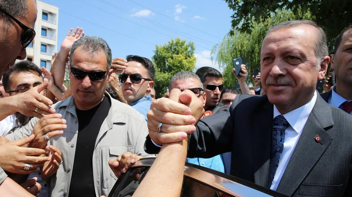 Turkey President Recep Tayyip Erdogan shakes hands with the people outside the Osmanli mosque construction during his visit, in Ankara, Turkey, Thursday, July 28, 2016 (File Photo: AP)