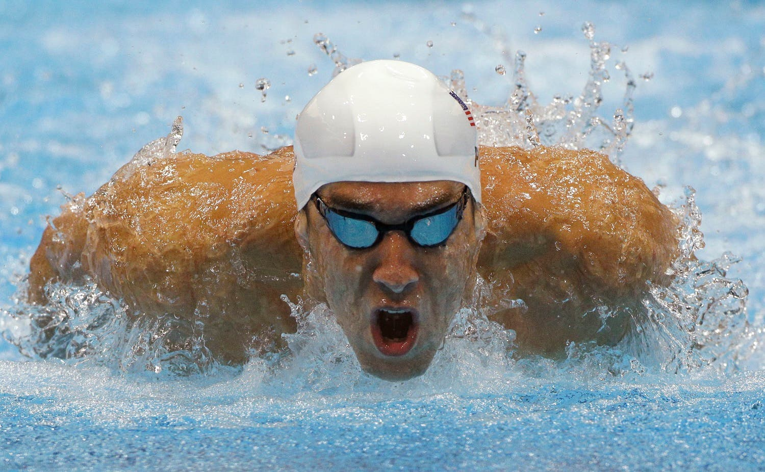 Michael Phelps competes in a heat of the men's 400-meter individual medley at the 2012 Summer Olympics in London. AP