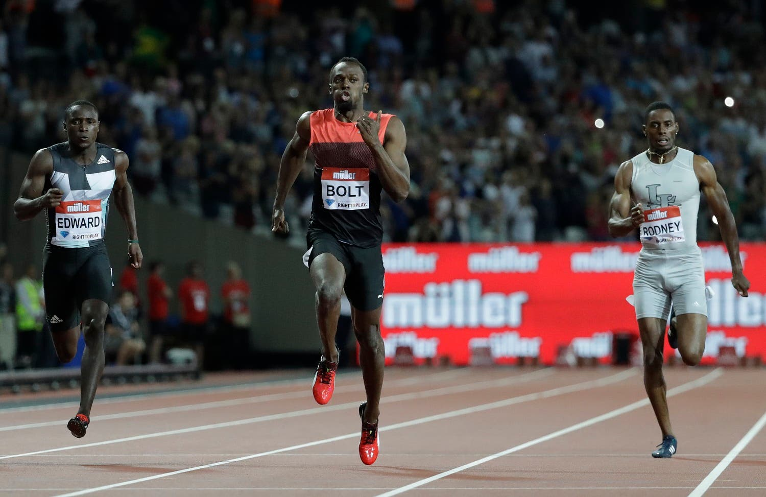 Usain Bolt of Jamaica, centre,runs onto win the men's 200 meter race during the Diamond League anniversary games at The Stadium, in the Queen Elizabeth Olympic Park in London, Friday, July 22, 2016. (AP)
