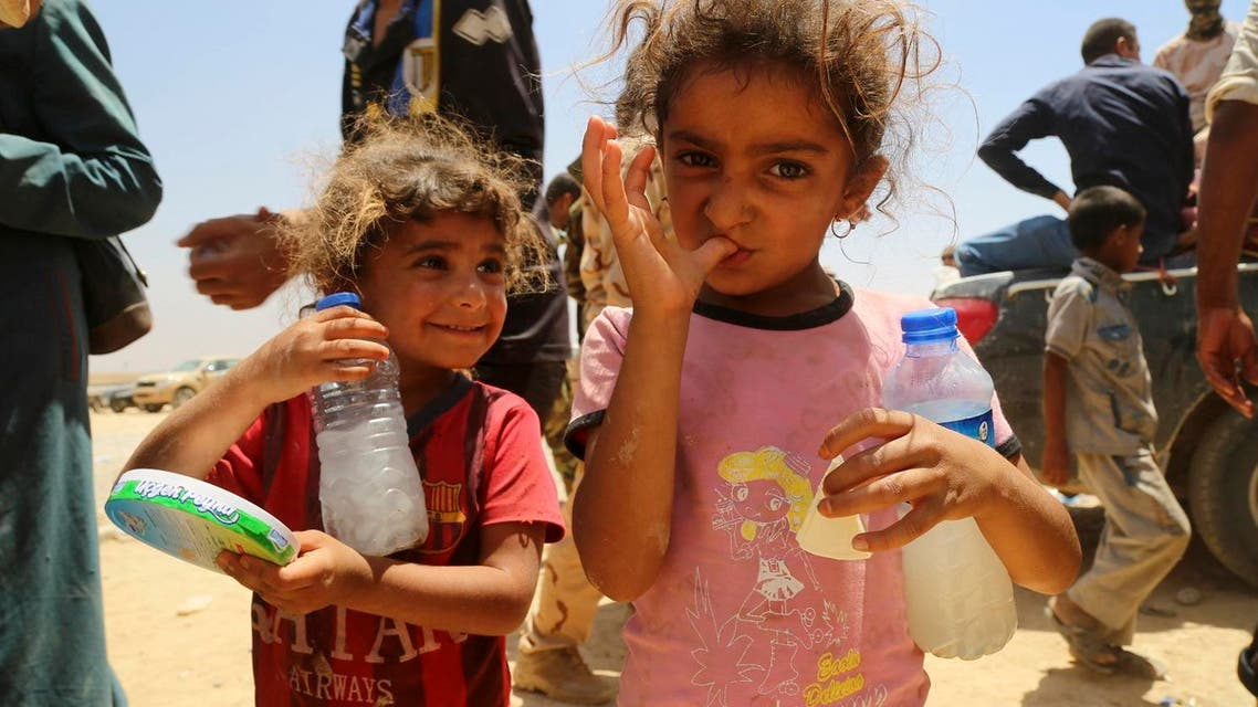 Two girls and other displaced civilians, who fled their ISISheld towns and villages south of Mosul during fighting between Iraqi security forces and Islamic State militants, arrive to a camp for displaced outside Irbil, 217 miles (350 kilometers) north of Baghdad, Iraq. (File Photo: AP)
