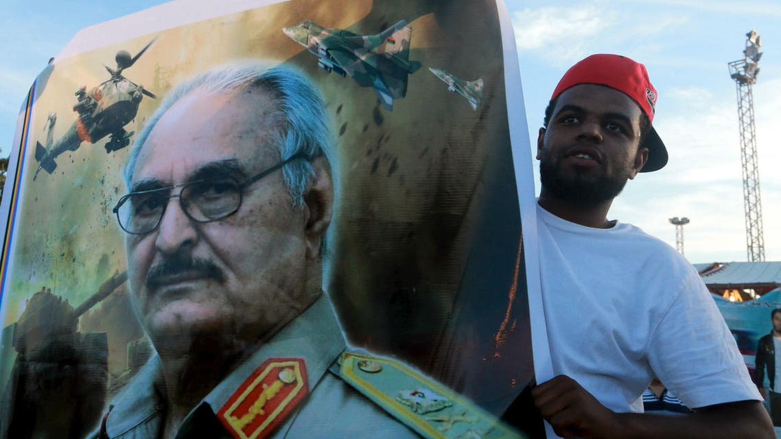 A man holds a picture of General Khalifa Haftar during a demonstration in support of the Libyan army under the leadership of General Khalifa in Benghazi, Libya November 6, 2015. (Reuters)