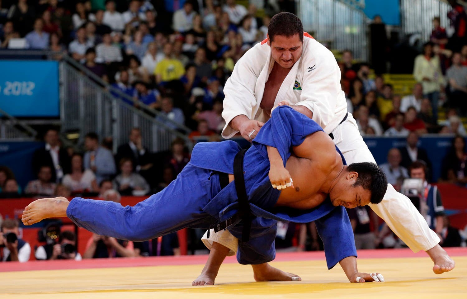 Brazil's Rafael Silva (white) fights with South Korea's Kim Sung-min during their men's +100kg bronze medal judo match at the London 2012 Olympic Games August 3, 2012. REUTERS