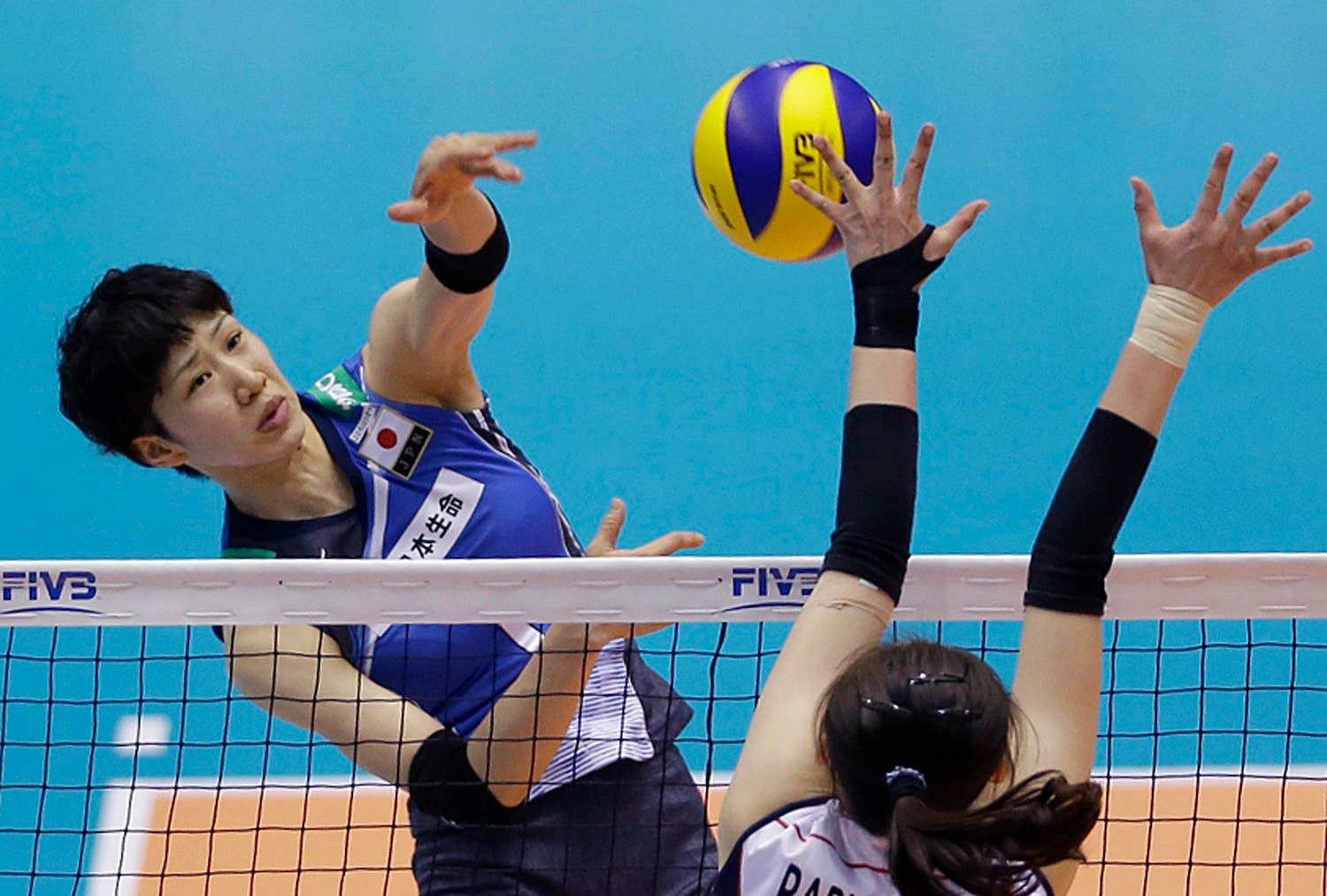 Miyu Nagaoka of Japan spikes against Park Jeong-ah of South Korea during their Women's Volleyball World Olympic Qualification Tournament in Tokyo, Tuesday, May 17, 2016. (AP)