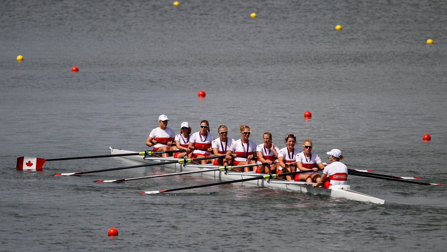 Team Canada row with their silver medals after the victory ceremony following the women's eight finals rowing event during the London 2012 Olympic Games at Eton Dorney August 2, 2012. (Reuters)
