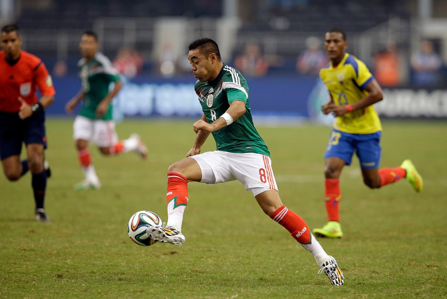 In his May 31, 2014 picture Mexico midfielder Marco Fabian controls the ball against Ecuador during a friendly soccer match in Arlington, Texas. Eintracht Frankfurt has signed Mexico midfielder Marco Fabian, the Bundesliga club says Thursday Dec. 24, 2015. The attacking midfielder signed a contract through mid-2019. Fabian last played for CD Cruz Azul on loan from Deportivo Guadalajara. He was on the Mexican team at the 2014 World Cup in Brazil and won gold with Mexico at the 2012 London Olympics. (AP)