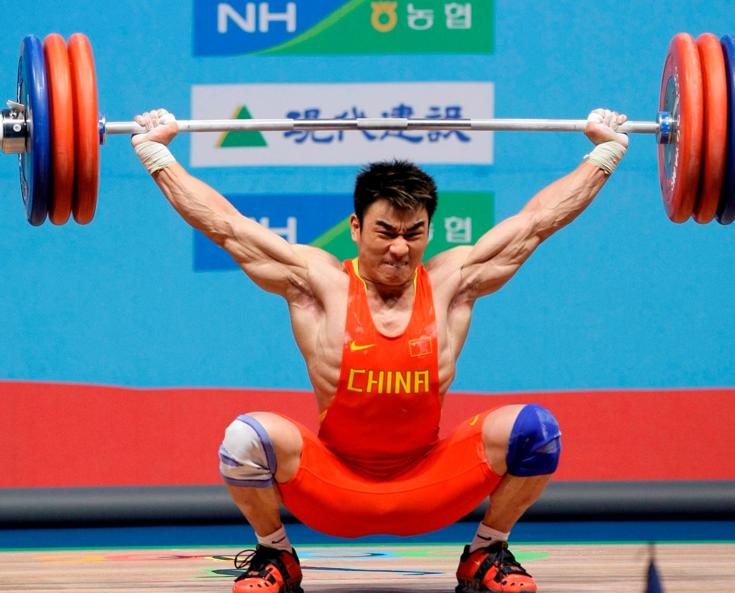 China's Liao Hui competes in the snatch during the men's group A 69-kilogram category of the World Weightlifting Championships in Goyang, west of Seoul, South Korea. (AP)