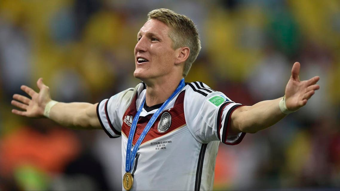In this July 13, 2014 file photo Germany's Bastian Schweinsteiger celebrates after the World Cup final soccer match between Germany and Argentina at the Maracana Stadium in Rio de Janeiro, Brazil. Germany won the match 1-0. Germany captain Bastian Schweinsteiger said Friday, July 29, 2016 he is quitting the national team. The 31-year-old said in a Twitter statement that he's asked Germany coach not to include him in the line-up in future. (AP Photo/Martin Meissner, file)
