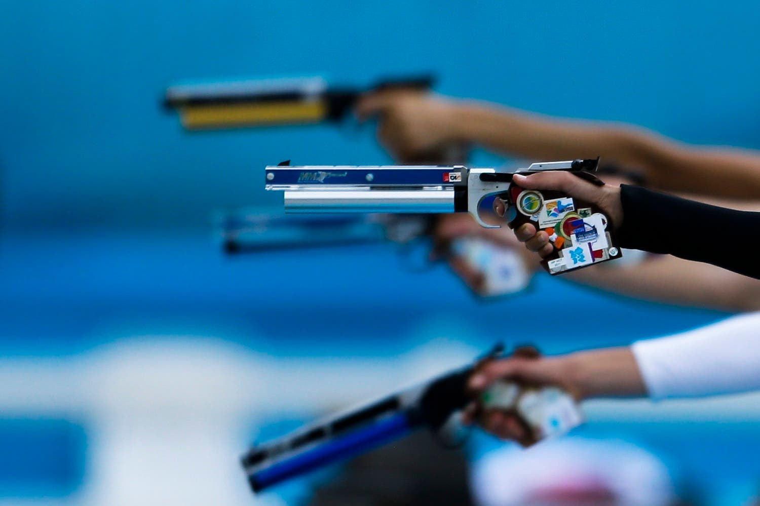 Competitors take aim in the combination running and shooting stage of the women's modern pentathlon, at the 2012 Summer Olympics, Sunday, Aug. 12, 2012, in London. (AP