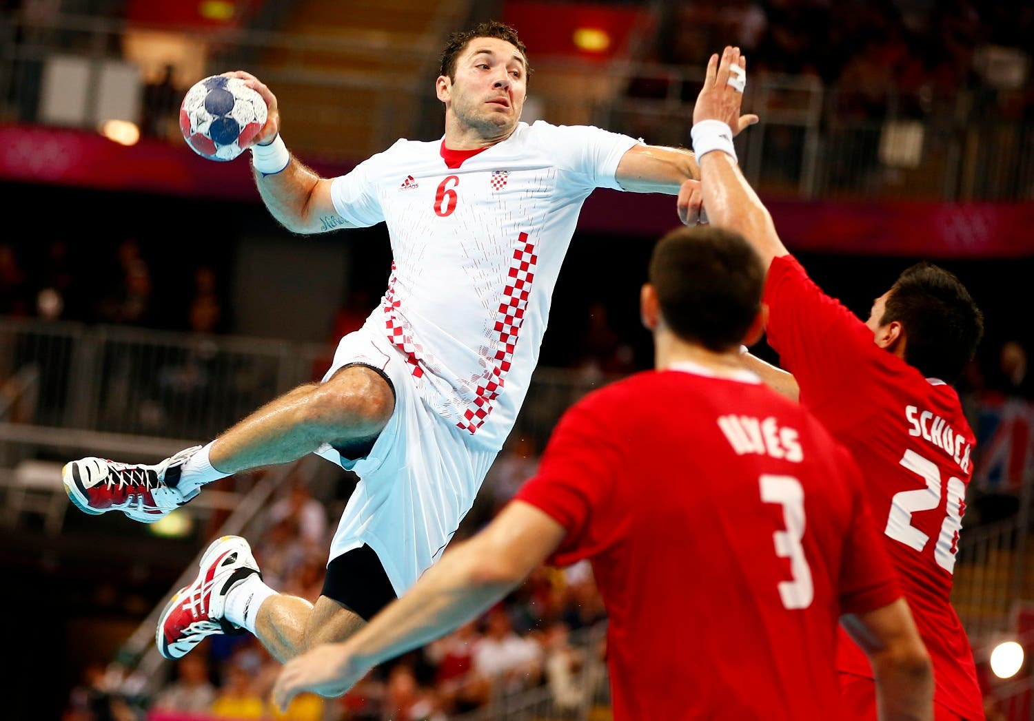 Croatia's Blazenko Lackovic scores against Hungary during their men's bronze medal handball match during the London 2012 Olympic Games at the Basketball Arena August 12, 2012. REUTERS