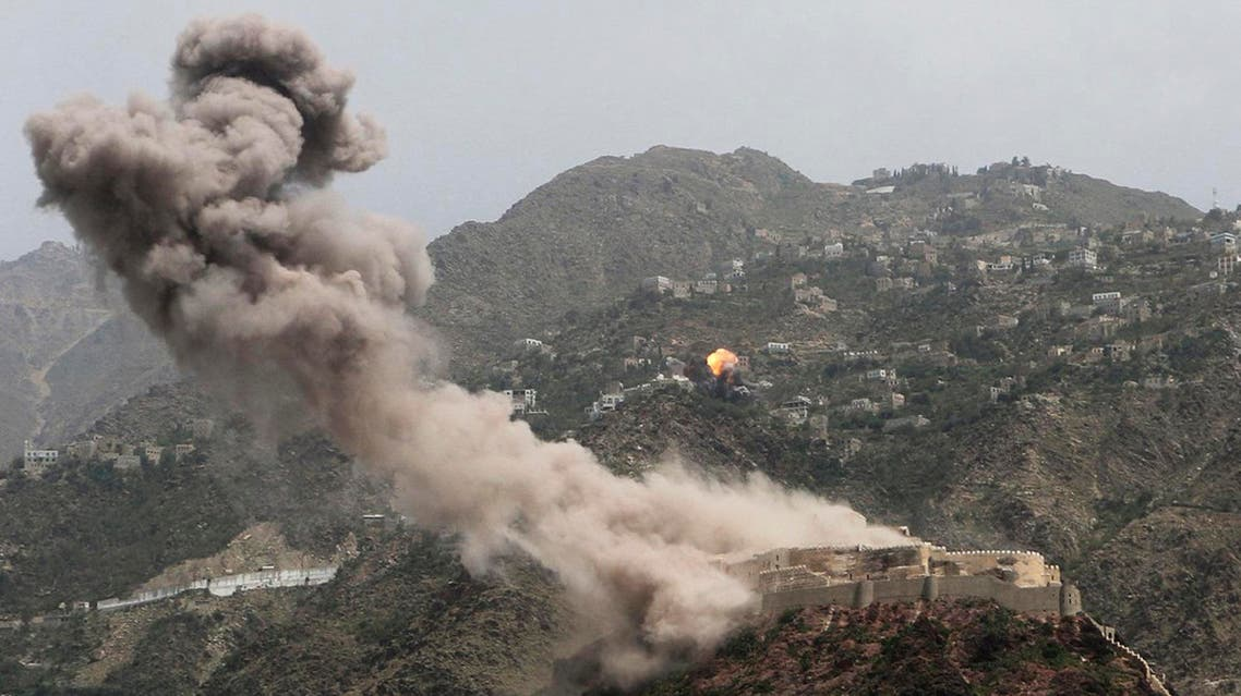 FILE - In this May 21, 2015, photo, smoke rises from al-Qahira castle, an ancient fortress that was recently taken over by Shiite rebels, as another building on the Saber mountain, in the background, explodes after Saudi-led air strikes in Taiz city, Yemen. The the air campaign waged by the Saudi-led, U.S.-backed coalition in Yemen has been increasingly criticized by human rights activists over civilian deaths. Yet arms deals continue, especially from the U.S. (AP Photo/Abdulnasser Alseddik, File)