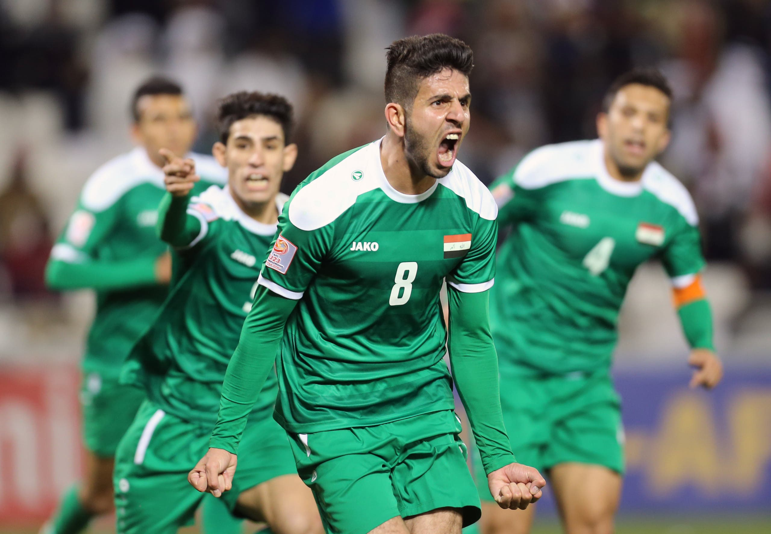 Iraq's forward Mohanad Abdulraheem Karrar celebrates scoring his team's equalizing goal during their AFC U23 Championship 3rd place football match between Qatar and Iraq in Doha on January 29, 2016. (AFP)