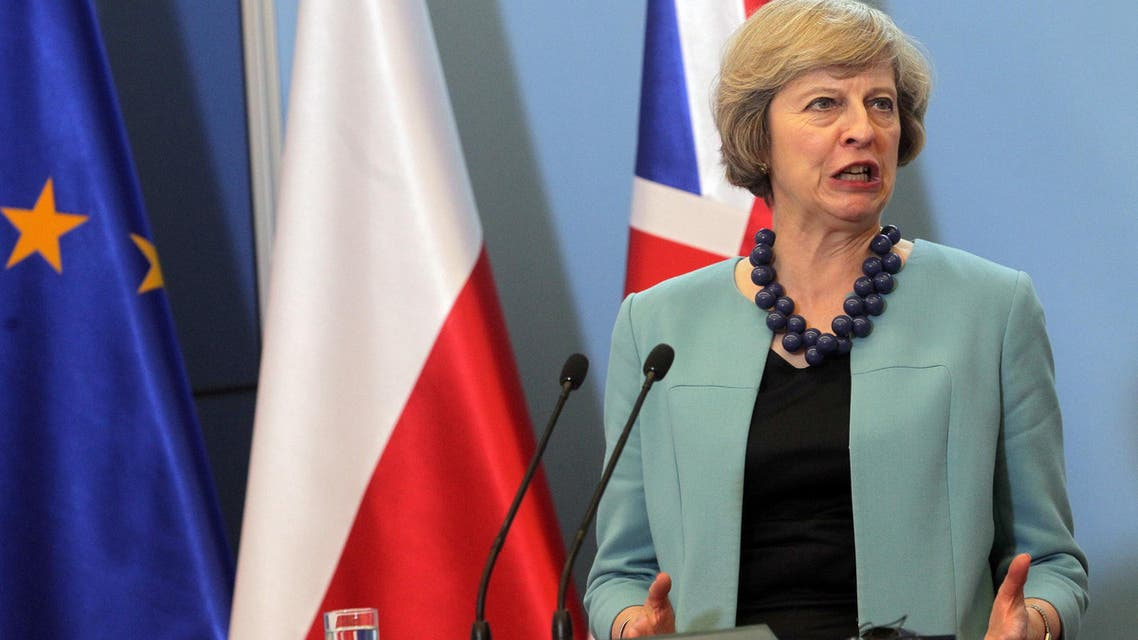 Britain's Prime Minister Theresa May attends a news conference at the Prime Minister's Chancellery in Agencja Gazeta/Przemek Wierzchowski/via REUWarsaw, Poland July 28, 2016. TERS ATTENTION EDITORS - THIS IMAGE WAS PROVIDED BY A THIRD PARTY. FOR EDITORIAL USE ONLY. POLAND OUT. NO COMMERCIAL OR EDITORIAL SALES IN POLAND