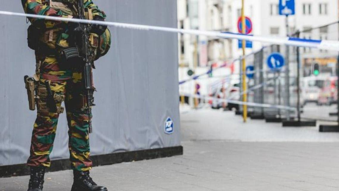 AFP I An armed soldier stands behind a cordon in central Brussels on July 20, 2016