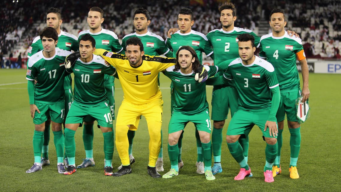 Iraq's starting eleven pose for a group picture ahead of their AFC U23 Championship 3rd place football match between Qatar and Iraq in Doha on January 29, 2016. (AFP)