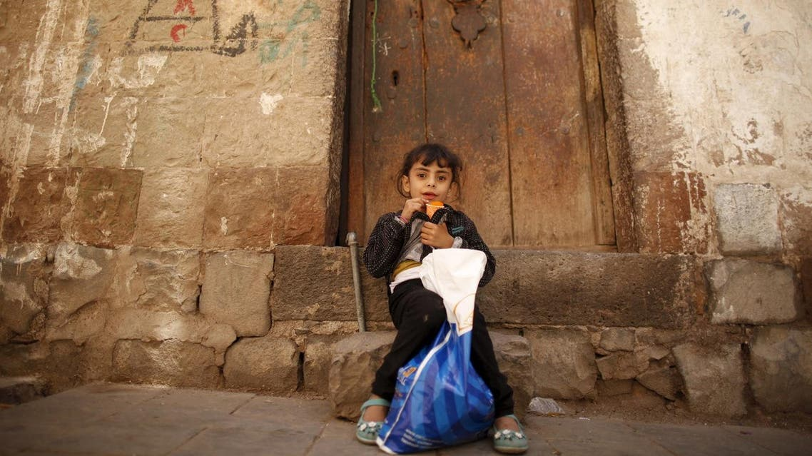 A girl sits outside a house during the first day of a ceasefire in Yemen's capital Sanaa April 11, 2016. REUTER