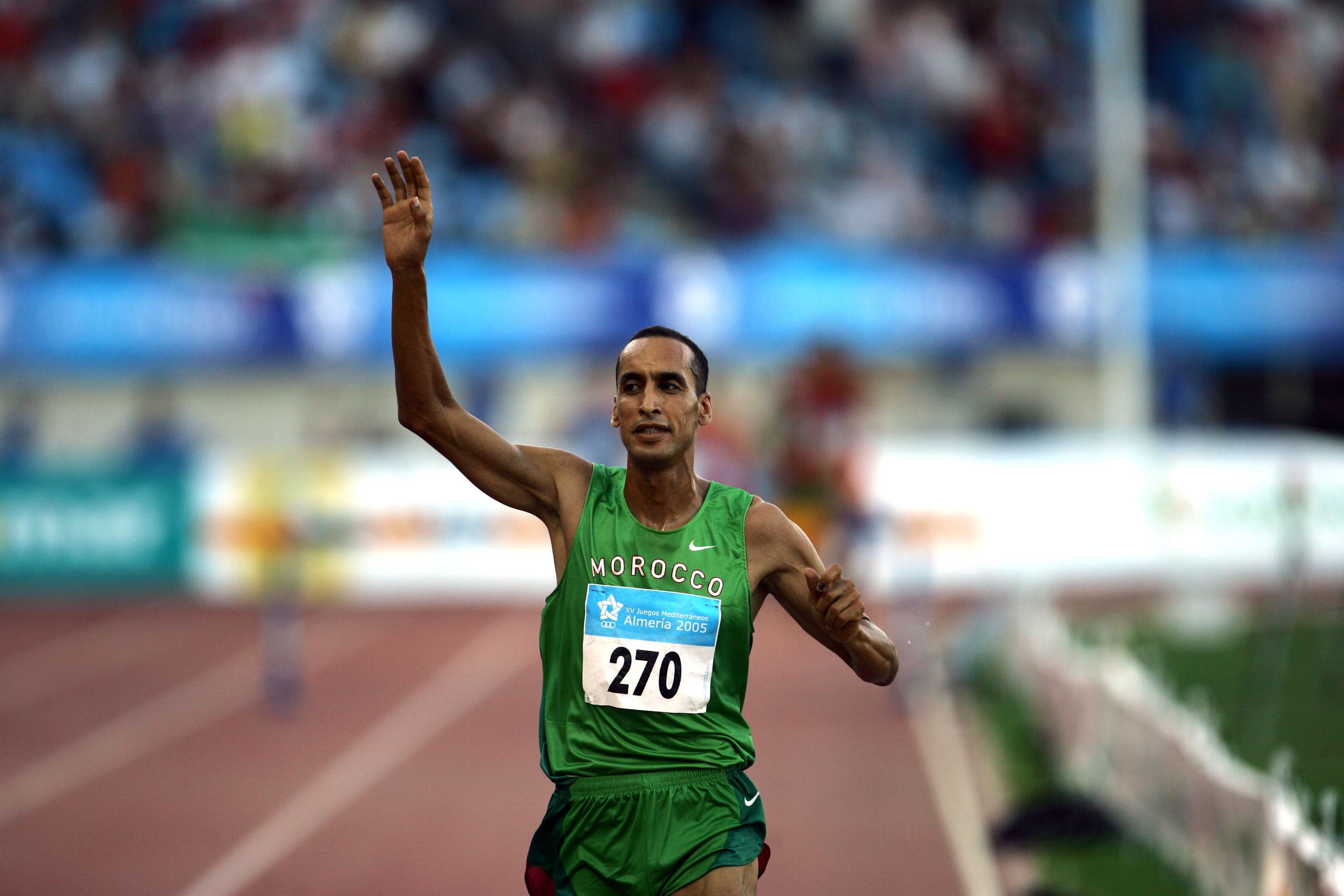 Morocco's Boulami celebrates winning men's 3000 metres steeplechase at the XV Mediterranean Games Almeria 2005 in Almeria. Morocco's Brahim Boulami celebrates winning men's 3000 metres steeplechase final at the XV Mediterranean Games Almeria 2005, southern Spain, July 1, 2005. Boulami won the gold medal with Spain's Antonio Jimenez taking the silver and France's Gael Pencreach bronze. (Reuters)