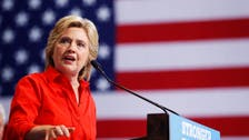 Clinton accuses Russian intelligence services of hacking DNC