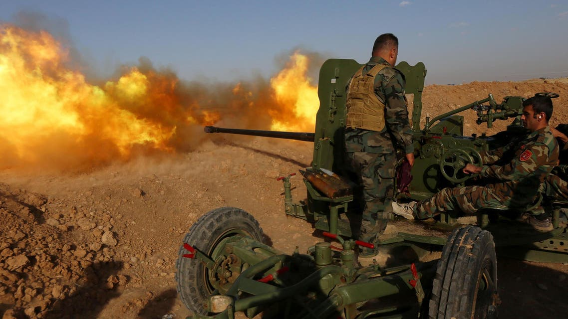Iraqi Kurdish Peshmerga fighters fire an anti-tank cannon on the front line near Hasan Sham village, some 45 kilometers east of the city of Mosul, during an operation aimed at retaking areas from the Islamic State group on May 29, 2016. (Reuters)