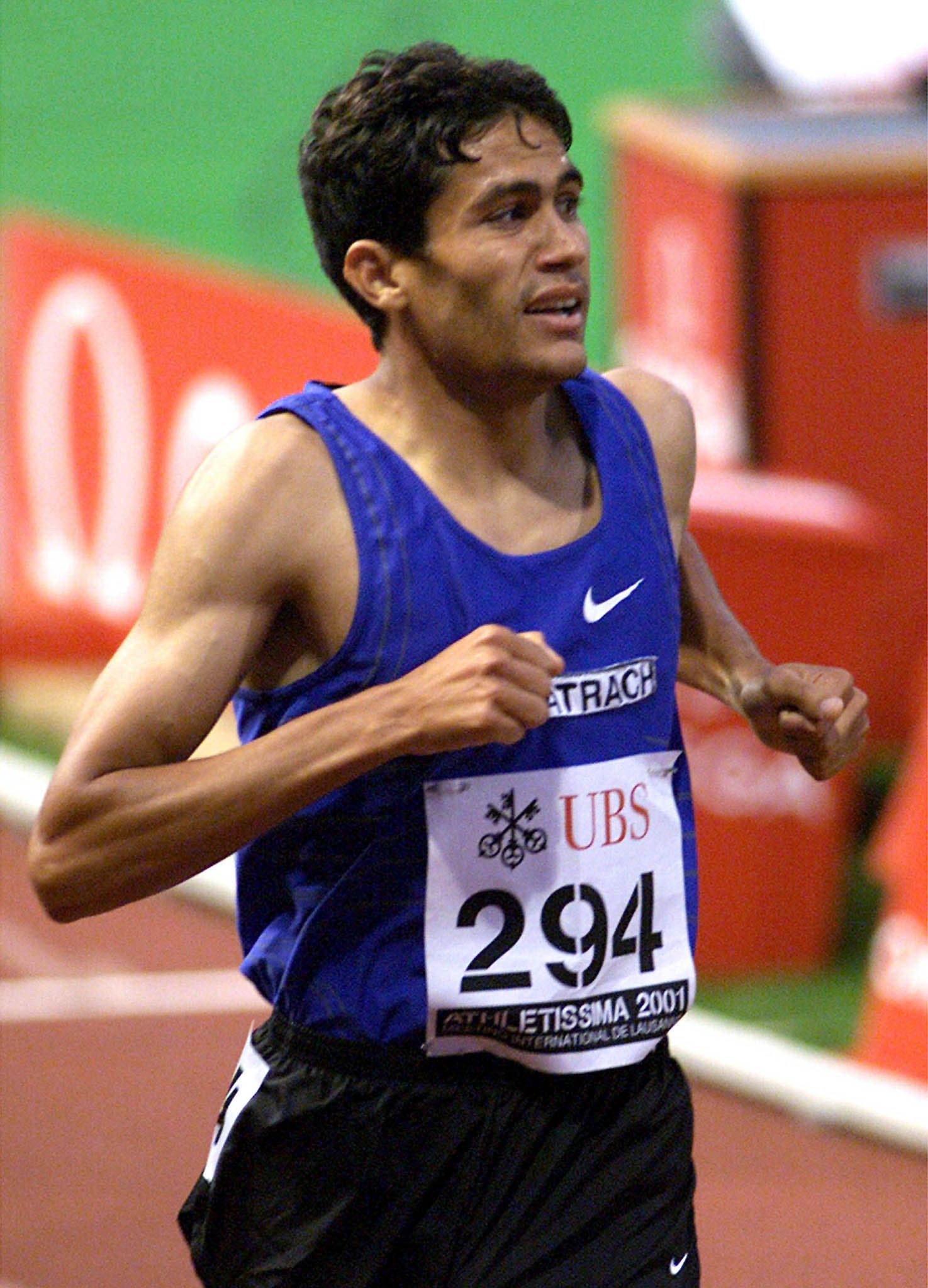 Ali Saidi-Sief of Algeria crosse the finish line to win the 1500m race at the Lausanne Grand Prix athletics meeting in Lausanne July 4, 2001. Sief won the race in a time of three minutes 29.51 seconds. (Reuters)