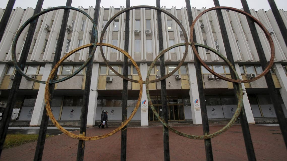 A view through a fence shows the Russian Olympic Committee headquarters, which also houses the management of Russian Athletics Federation in Moscow, Russia, November 10, 2015. The Russian Sports Ministry said on Tuesday it was open for closer cooperation with the World Anti-Doping Agency (WADA) in order to eliminate any irregularities committed by the Russian anti-doping watchdog and its accredited laboratory. WADA has recommended that Russian athletes are excluded from international events including the 2016 Olympic Games in Brazil. REUTERS