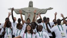 Athletes in Rio Olympics' refugee team carry flag for others