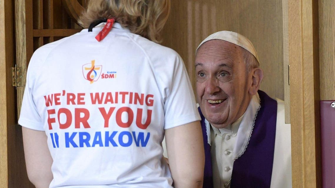 Pope Francis confesses a youth at the Divine Mercy Sanctuary in Krakow, Poland AP