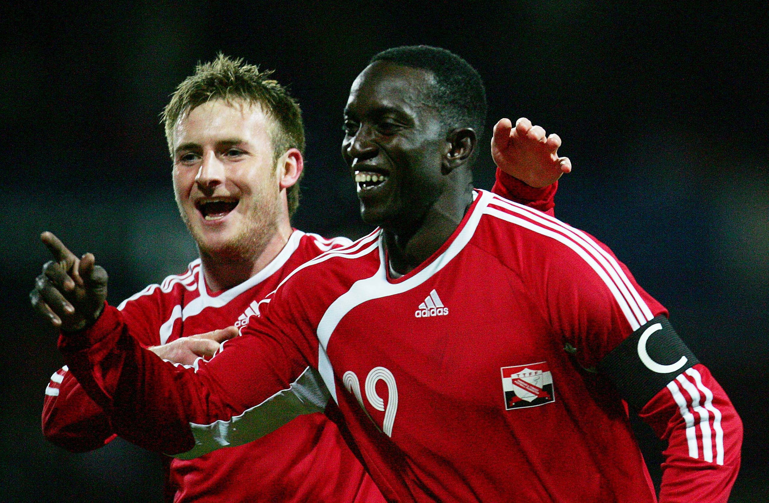 Trinidad and Tobago's Dwight Yorke (R) celebrates his goal with Chris Birchall during their international friendly soccer match against Iceland at Loftus Road, London, February 28, 2006. (Reuters)