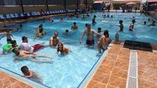 Iraqis take swimming to ward off searing heat