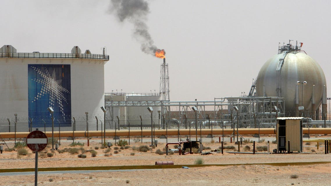 A gas flame is seen in the desert near the Khurais oilfield, about 160 km (99 miles) from Riyadh, Saudi Arabia June 23, 2008. REUTERS/