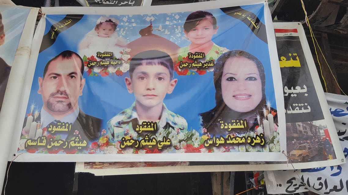 A sign of missing family is seen at the site of a Karrada suicide bomb attack in Baghdad, Iraq July 26, 2016. (Reuters)