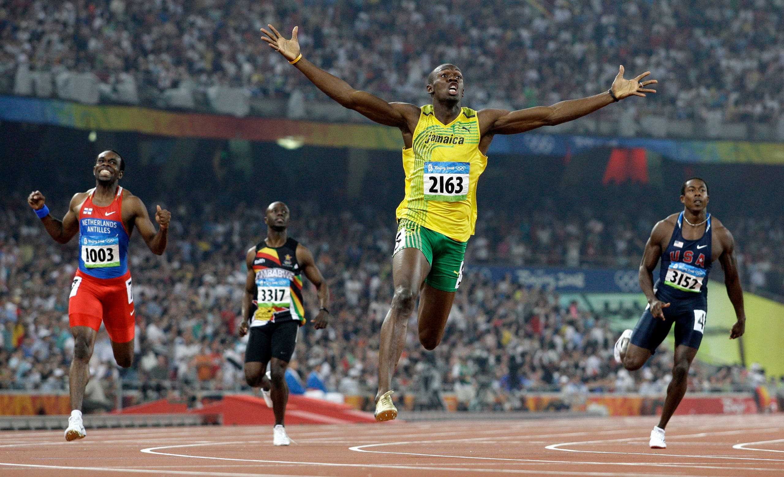 Jamaica's Usain Bolt crosses the finish line to win the gold in the men's 200-meter final during the athletics competitions in the National Stadium at the Beijing 2008 Olympics in Beijing. (AP)
