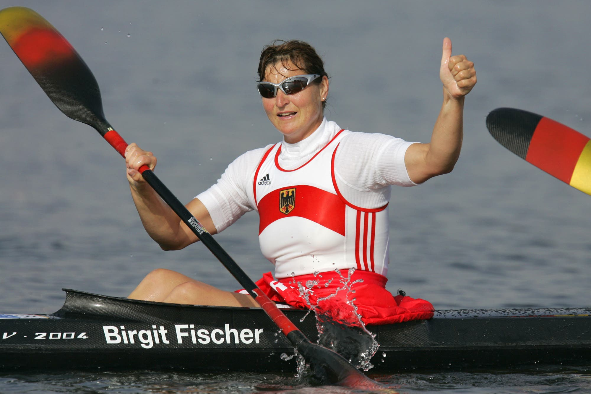 Germany's seven-time kayaking gold medalist Birgit Fischer celebrates after she and her teammates won the Women's K4 500 meter final to take the gold medal, during the kayak flatwater event at the 2004 Olympic Games in Schinias near Athens, Greece, Friday, Aug. 27, 2004. (AP)