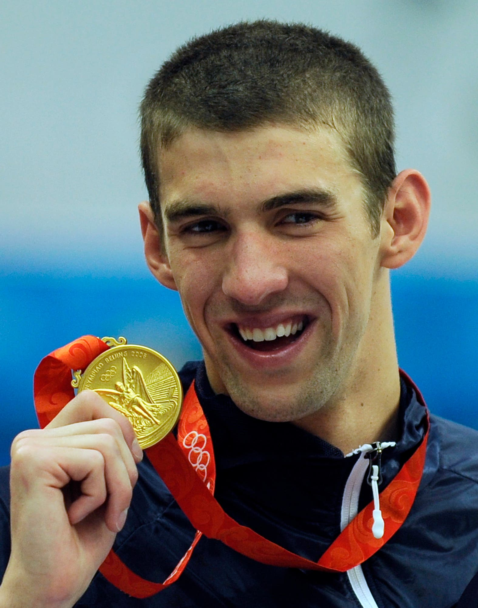 Michael Phelps displaying his eighth gold medal after the men's 4x100-meter medley relay final at the Beijing 2008 Olympics in Beijing. (AP)