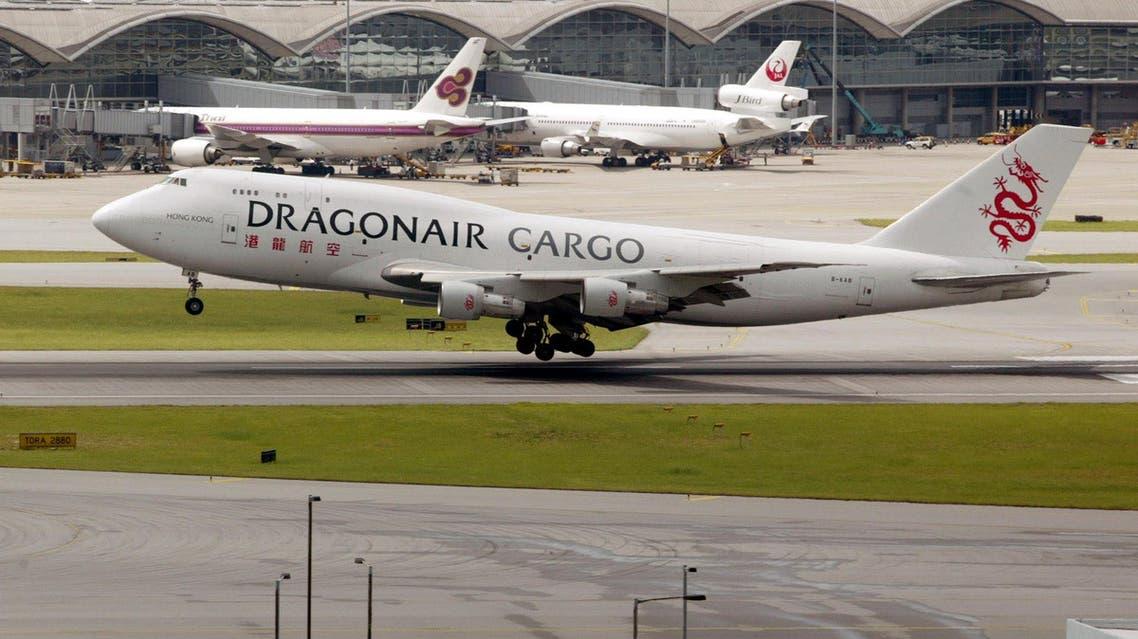 A Hong Kong-based Dragonair cargo plane lands at the Hong Kong airport July 23, 2002. (Reuters)