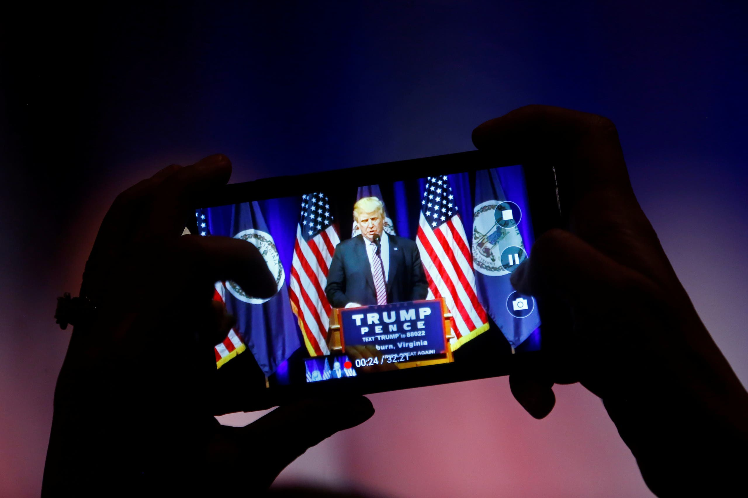 A supporter photographs Republican U.S. Presidential nominee Donald Trump during a campaign event at Briar Woods High School in Ashburn, Virginia, U.S., August 2, 2016. (Reuters)