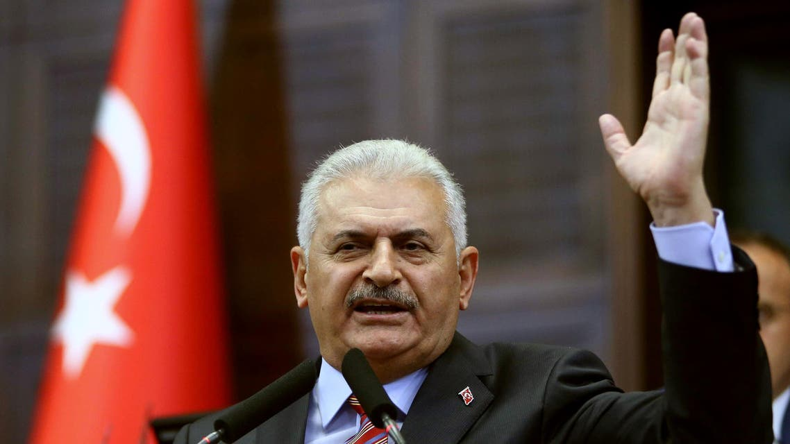 Turkish Prime Minister Binali Yildirim speaks during a meeting of his Turkish ruling Justice and Development Party (AKP) group at the Grand National Assembly of Turkey (TBMM) in Ankara on August 2, 2016. AFP