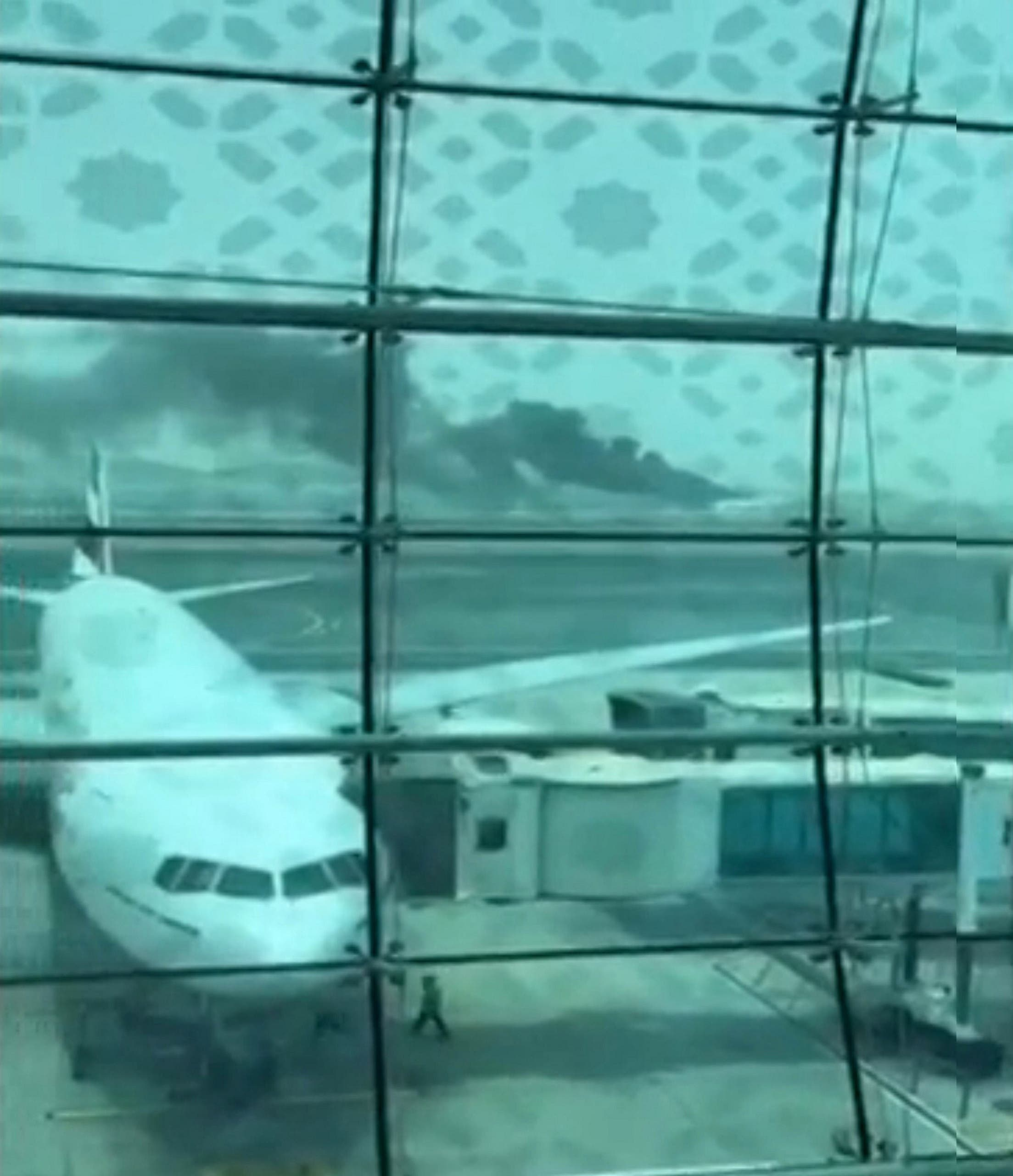 Still picture taken from an amateur video shows smoke after an Emirates Airline flight crash-landed at Dubai International Airport. (Reuters)